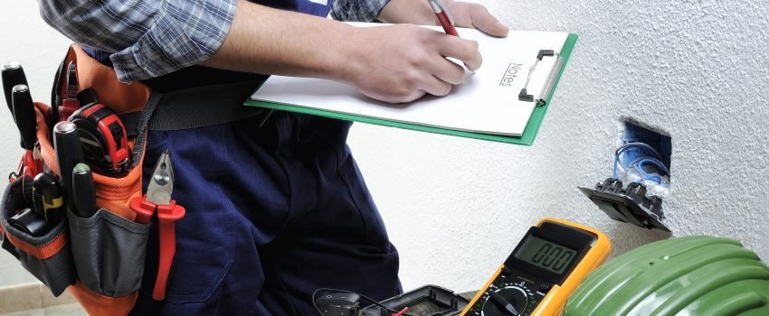 Young electrician estimating in a residential electrical installation